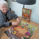 Female resident putting together a jigsaw puzzle