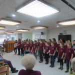 Children performing for residents